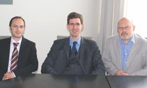 Слева направо: М. Гозман, депутат Й. Петерсен и С. Мучник