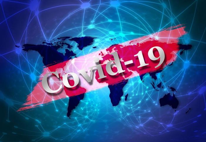 знгак коронавируса на фоне карты мира