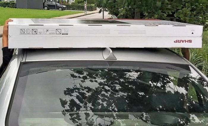 телевизор на крыше авто